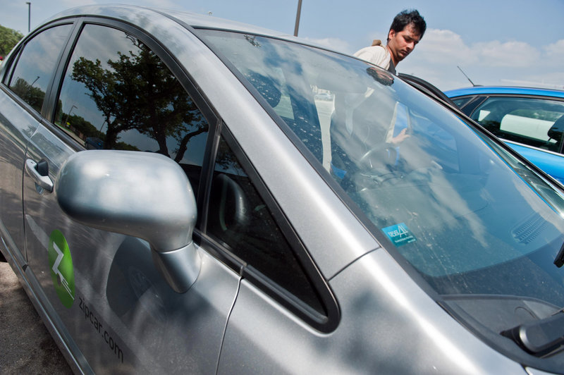 Computer science student Ashwin Chan rents a Zipcar on the UT-Dallas campus in Richardson, Texas. Zipcar hopes to reshape the American culture of car ownership.