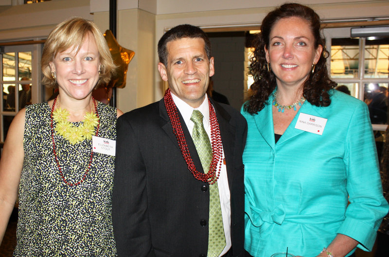 Board president Liz Stout of Givertz, Schefee & Lavoie, Don Legere of Cross Insurance and Nina Garrison of Signature Capital.