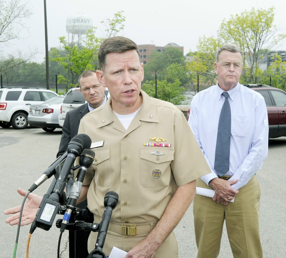 John Patriquin/Staff Photographer.Thurs., May,24,2012. Rear admiral Rick Breckenridge is joined by NH director of homeland security & emergency management Chris Pope (left) and director of Maine emergency management administration Rob McAleer at a Press conference at the gate of the Portsmouth Naval Shipyard.