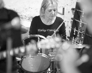JANET BISSELL, of Duluth, Minn., plays the drums for the Grrrl Band during a practice session.