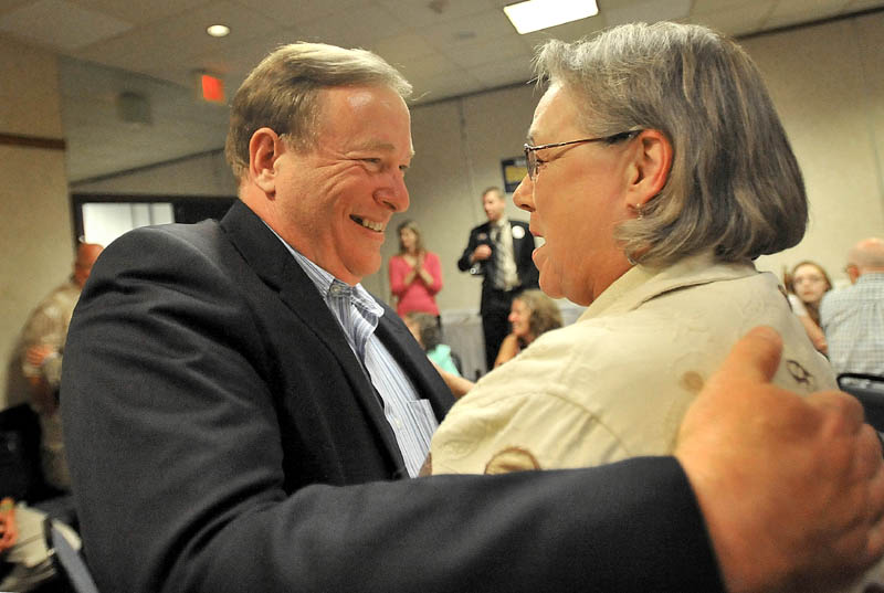 Kevin Raye is congratulated by supporter Gail Kelly after winning the Republican nomination in the 2nd District U.S. House race in Bangor Tuesday night.