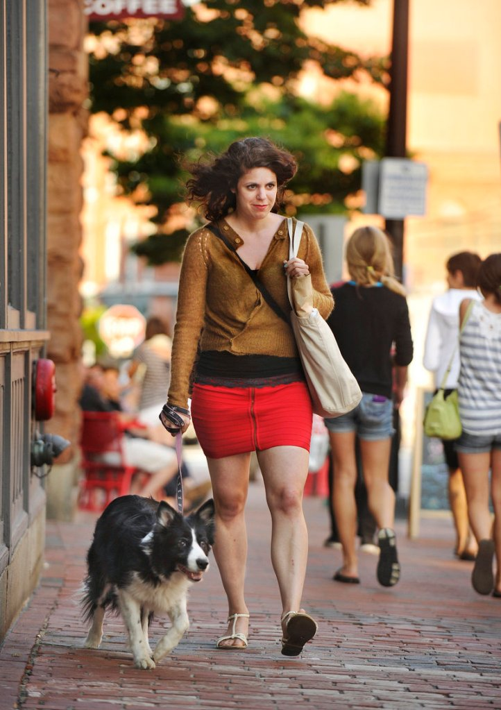 Jessie Lacy gave up her car three years ago. Her daily commute now is a 10-minute walk, often with her dog, from her Grant Street apartment to her job on Exchange Street.