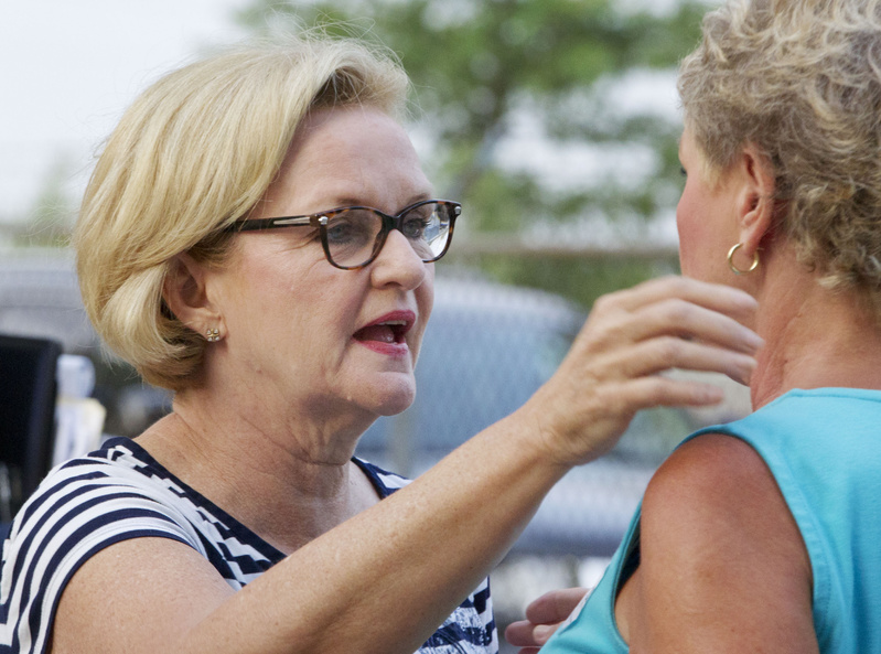 Sen. Claire McCaskill, D-Mo., talks with a supporter at the Missouri State Fair in Sedalia, Mo., last week. On Thursday, McCaskill derided a new survey that suddenly showed her leading Republican Todd Akin by 10 points -- 48 to 38 percent.