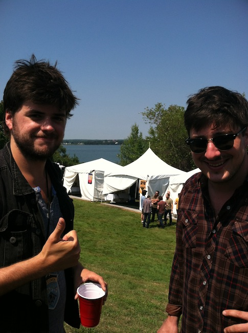 "Winston Marshall and Marcus Mumford from Mumford & Sons hang out backstage on the Eastern Promenade at the ""Gentlemen of the Road Stopover"" music festival in Portland."