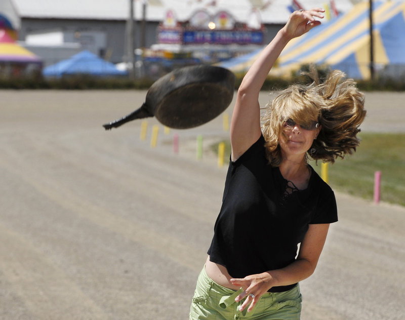A contestant lets it rip in the Frying Pan Toss at the Topsham Fair.