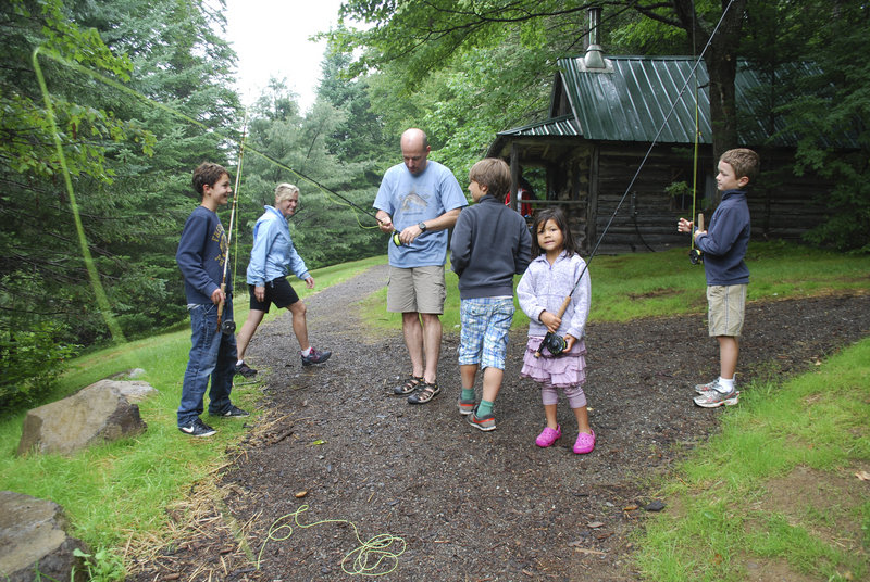An assortment of fishermen gathers at Little Lyford Lodge for a fly fishing lesson. From left are Louk James of Amsterdam; Carrie Balderston of Bend, Ore., and her husband, Brent; Max James of Amsterdam; and Keira Paterson and Jake Butler of California.