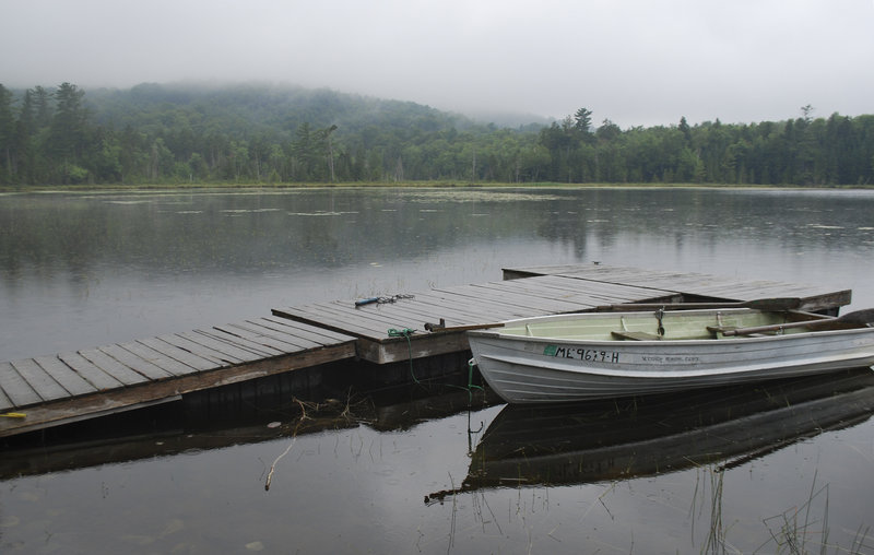 Rowboats and canoes sit at the ready at Little Lyford Pond beside the AMC's wilderness lodge. The group hopes more fly fishermen take advantage of the waters.