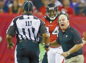 ATLANTA FALCONS' head coach Mike Smith, right, argues for a pass interference call on a play involving wide receiver Roddy White, center, with an official during the second half of their NFL football game against the Denver Broncos on Monday in Atlanta. The Falcons won 27-21.