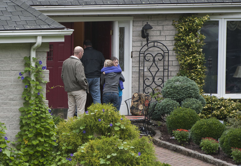 Visitors arrive at the home of Jeffrey Giuliano in New Fairfield, Conn., on Friday. Giuliano fatally shot a masked teenager during what appeared to be an attempted burglary Thursday, then discovered that he had killed his son, Tyler.