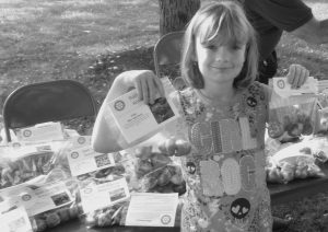 ALEX BROOKS OF ARROWSIC holds packages of the bulbs she bought for her garden as part of the The Bath Sunrise Rotary Club's third annual Bulb Sale, which helps fund its many local projects. Bulbs can be purchased Saturdays at the Bath Farmers Market, or call Bob Reed at 844-0451.
