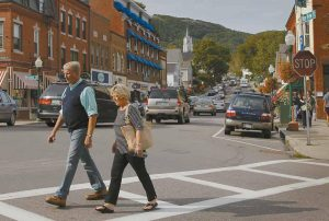A COUPLE STROLLS through Camden. The small coastal Maine town is often cited in lists of best retirement places to move for people interested in cooler climates.