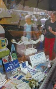 """A BOOK CALLED """"Maine Staycation"""" sits on display in a storefront in Camden."""
