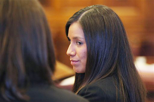 Alexis Wright, 29, turns towards her attorney Sarah Churchill, left, during her arraignment in Portland in this Oct. 9, 2012, photo. She faces 109 counts of prostitution, violation of privacy, tax evasion and other charges for allegedly providing sex for money at her Kennebunk fitness studio and office.