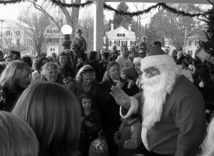 SANTA CLAUS HAS BEEN KNOWN to frequent areas in Bath. Here he is last year greeting residents prior to the annual tree lighting ceremony.