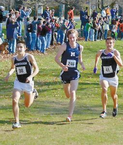 BOWDOIN COLLEGE RUNNER Coby Horowitz (left) won a sprint to the finish on Saturday to claim the Division III Regionla Cross Country crown. On the right is teammate Sam Seekins, who took second.