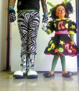 KIKA-EVOLUTION, 5, an Auguste clown, in upper photo, also poses for the above portrait with her father, Rayito Show, at the clown convention in Mexico City.