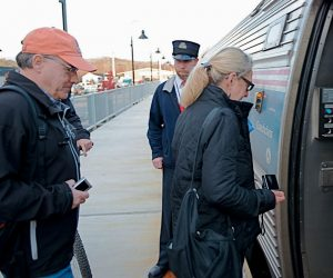 THE AMTRAK DOWNEASTER PICKED UP Brunswick-area residents Steven and Joanna Bradley and dozens of others after being more than an hour late for the first day of service Friday morning. The Bradleys were celebrating Steven's birthday by taking the train to Boston and spending the day there.