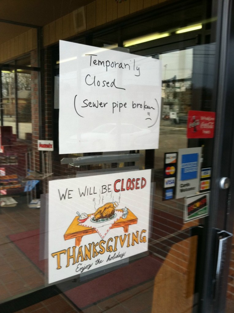 A sign on the door of the Wok Inn on Forest Avenue in Portland on Tuesday informed customers the restaurant was closed because of a sewer pipe issue.