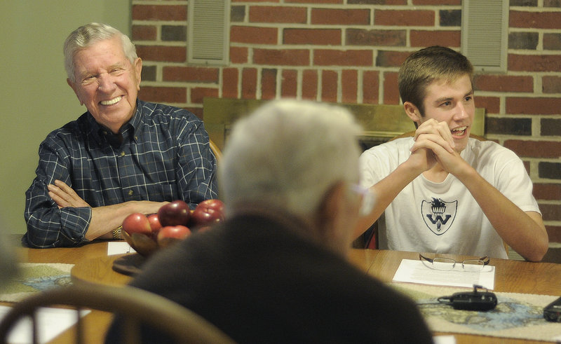 "Bill Currier, left, shares a laugh with Westbrook High School junior Morgan Rielly, right, at Rielly's house last Monday. Rielly interviewed Currier, along with other veterans, for a book he wrote titled ""Neighborhood Heroes: Life Lessons Learned from Maine's Greatest Generation."""