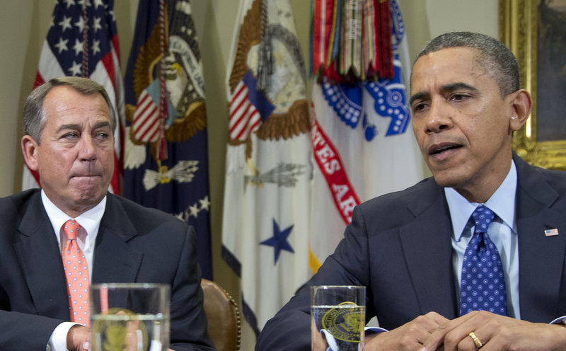 President Obama, accompanied by House Speaker John Boehner, R-Ohio, speaks to reporters at the White House on Friday. More than $600 billion in higher taxes and across-the-board spending cuts will kick in for the coming year Jan. 1 without a deal in Washington to reduce the federal deficit. Maine could realistically expect to lose 6,000 to 10,000 jobs if the spending cuts go through, USM economist Charles Colgan estimated.