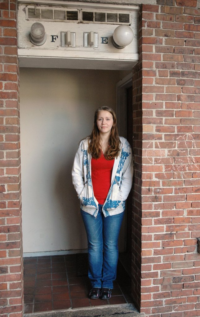 Folsom's next-door neighbor, Crystal Murphy, stands in the doorway of the apartment where Folsom was killed. She says everyone in the complex knows each other's business.