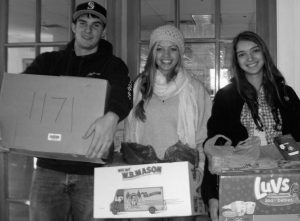 MORSE HIGH SCHOOL STUDENTS, from left, Paul Whalen, Sydne Cambeu and Elizabeth Walfield carry goods donated to a troop support program called Gifts of Gratitude based at The American Legion Smith Tobey Post 21 in Bath. The program ships care packages to deployed soldiers.