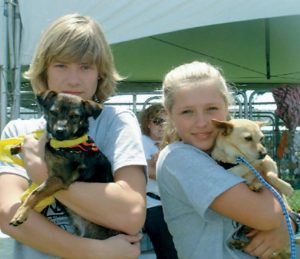 KIDS AGAINST ANIMAL CRUELTY founder Lou Wegner and West Virginia Chapter President actress Emily Capehart at the Best Friends Super Adoption, La Brea Tar Pits in Los Angeles.