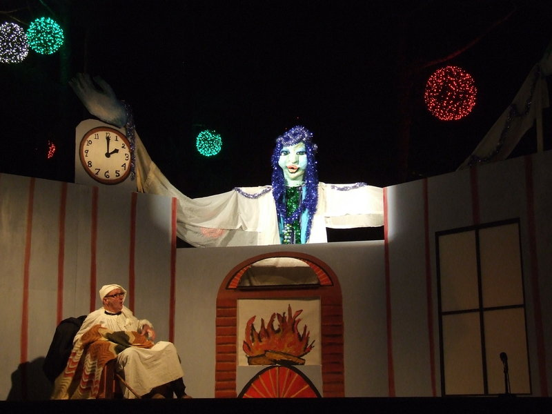 """The Shoestring Theater's production of """"A Christmas Carol"""" features a dozen or so human actors – adults as well as children – and hand puppets, rod puppets, shadow puppets, carnival puppets and a stilt walker."""