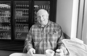 "BILL PERKINS, OF PHIPPSBURG, reflects on his days as a ""copy boy"" with the old Boston Post while enjoying a cup of coffee at Jimbo's Diner."