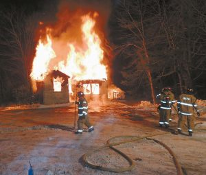 BRUNSWICK FIRE DEPARTMENT crews conducted a controlled house fire Monday night as a training exercise. The former dwelling on Church Road across from Business Parkway and adjacent to the Water Department monitoring substation, was torched shortly before 7 p.m. Half an hour later, it was engulfed and collapsed in on itself while firefighters periodically doused it with bursts from the hoses to keep it under control.