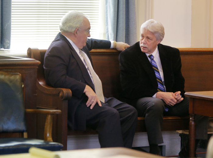 Mark Strong Sr., right, talks with his attorney, Dan Lilley, after Justice Nancy Mills dropped 46 charges against Strong at York County Superior Court in Alfred on Friday morning. Strong still faces 13 counts.