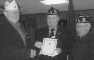 JOHN HARGREAVES, Department of Maine 1st Vice Commander, presents a membership achievement award to Brunswick Post 20 Membership Chairman Marty Diller, center, and Post 20 Chaplain Read Rich, at right. The Brunswick post achieved 100 percent membership for 2013 prior to Veterans Day 2012.