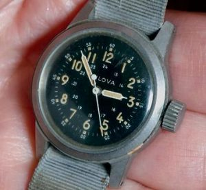 GERALD ADLER, 81, displays the watch he was wearing when he survived a B-52 bomber crash 50 years ago. The crash caused the watch to stop working, and is how authorities determined the time of the accident.