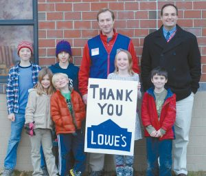 """STUDENTS FROM Great Salt Bay School in Damariscotta are shown with Lowe's Thomaston store manager Bill Doehring, left, and school principal Jeff Boston, right. The GSB playground has been designated a """"Lowe's Heroes"""" project, and will benefit from donated materials and volunteer labor provided by Lowe's."""