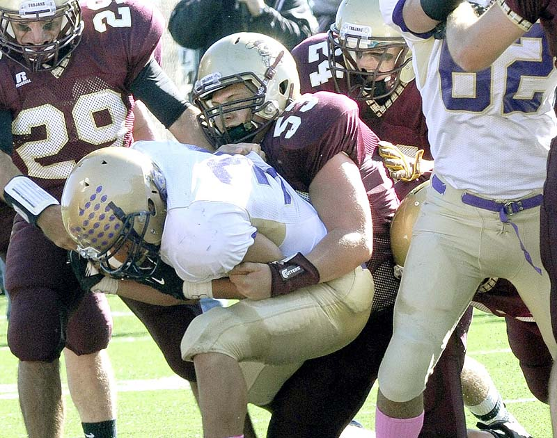Thornton's Bobby Begin makes a tackle in an October game last season against Cheverus. Begin and Kurt Massey of John Bapst won the Frank Gaziano Scholarship and Award Sunday as the top high school football offensive and defensive linemen in the state.
