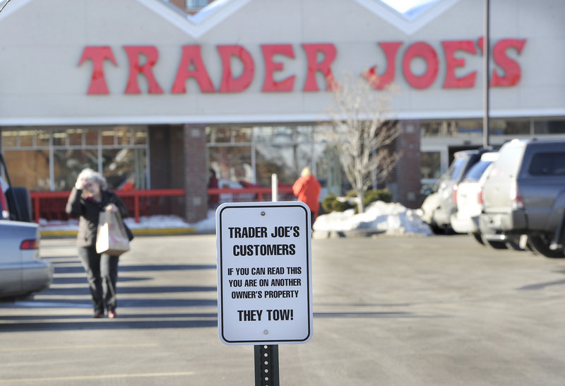 A sign warns Trader Joe's customers against parking in West Marine's lot along Marginal Way in Portland.