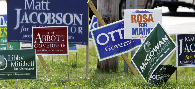 "Candidates' signs line a corner in Portland during the run-up to the 2010 gubernatorial primary. ""A nonpartisan blanket primary, or 'top-two' system,"" would send candidates to the general election who more closely reflect the preferences of the majority of voters, a reader says."