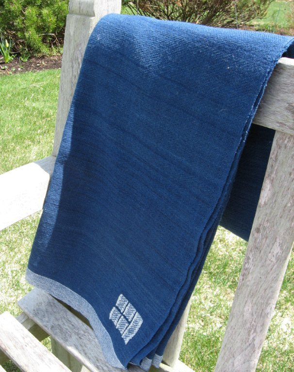 Swans Island Blankets' solid indigo throw sells for $495. The company makes hand-woven products with certified organic fibers and natural dyes.
