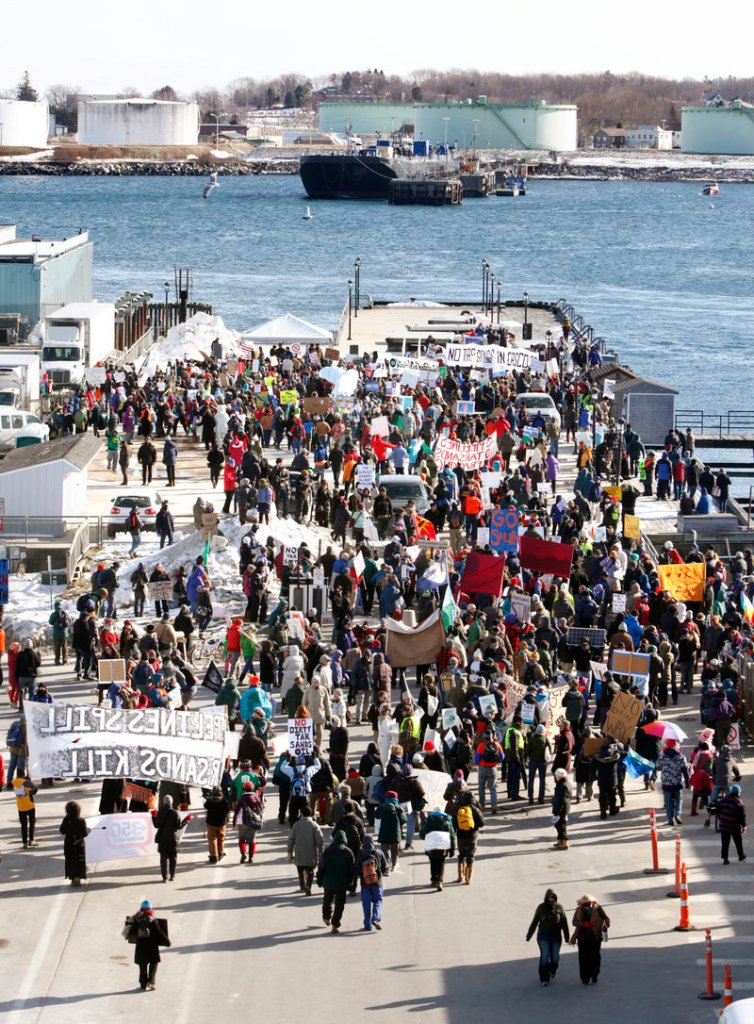 Demonstrators head to the Maine State Pier on Saturday to voice their opposition to piping tar sands oil through the region. Officials with the Portland Pipe Line Corp. say there is no existing plan to transport tar sands oil through the Portland-to-Montreal Pipe Line.