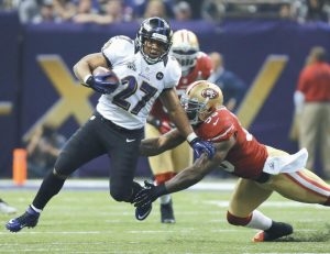 BALTIMORE RAVENS running back Ray Rice (27) is tackled by San Francisco 49ers linebacker Aldon Smith (99) during the second half of the NFL Super Bowl XLVII football game on Sunday in New Orleans.