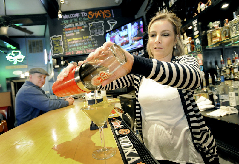 """Bartender Jennifer Brenerman pours a """"hot and dirty martini"""" at Shay's Grill Pub in Portland."""