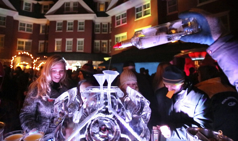 Vodka is poured into a funnel in an ice block during the Ice Bar at the Portland Harbor Hotel in Portland on Saturday, January 26, 2013. Ice bars have become hip, high-profile events across Maine.
