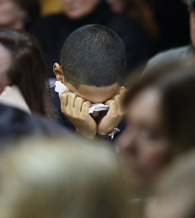 Mikey Epperson, 16, of New London, Conn., composes himself at a memorial service for his grandmother, Dale Fussell, at the United Church of Christ on Congress Avenue in Bath Tuesday, February 19, 2013. Fussell was killed Tuesday, Feb. 12, in a propane explosion at her Bluff Road duplex.