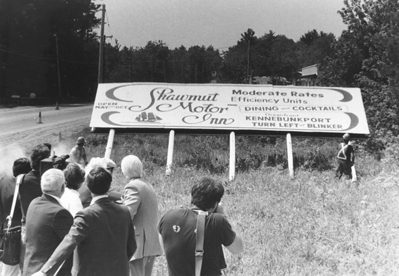 The last state-acquired billboard in Maine, on Route 1 in York County, is cut down by chain saw circa 1984.