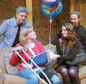 """A WELCOME home for injured photojournalist in a scene from """"Tie Stands Still"""" at The Public Theatre. From left are Evan Mueller, Janet Mitchko, Jessica DiGiovanni and David Newer."""