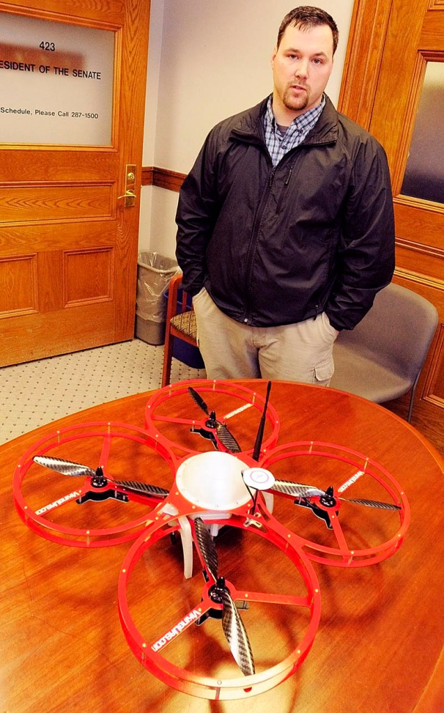 """In this Feb. 26, 2013 file photo, Christopher Taylor, president and drone designer for Viking Unmanned Aerial Systems of Limington, talks about his company's FR-Xtreme model that is on the table at the State House in Augusta. Maine State Police believe a toy drone the agency purchased in January would be a """"great reconnaissance tool,"""" according to internal agency records, but federal reulations suggest it would be illegal for police to use it."""