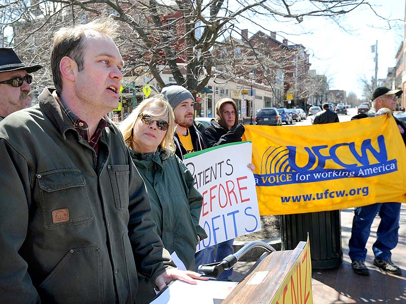 Matt Schlombohm, executive director of the Maine AFL-CIO, speaks about the ability of workers at Wellness Connection to unionize, at a news conference in Longfellow Square in Portland on Saturday.