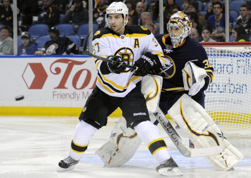 Patrice Bergeron tries to redirect a shot in front of Sabres goalie Ryan Miller during the Bruins' 2-0 win Sunday night in Buffalo.
