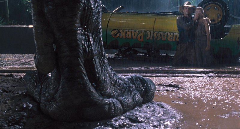 "Sam Neill and Joseph Mazzello hide in plain sight from a Tyrannosaurus in ""Jurassic Park 3D."""