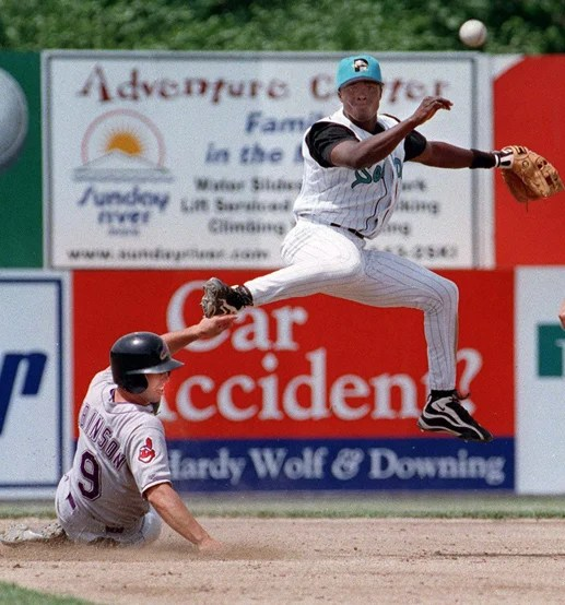 STAFF PHOTO BY HERB SWANSON -- Sunday, June 6, 1999 -- Pablo Ozuna fires to first base for a double play as Adam Robinson of the Akron Aeros turns to look after being forced out. Sea Dog early game action at Hadlock Field Herb Swanson